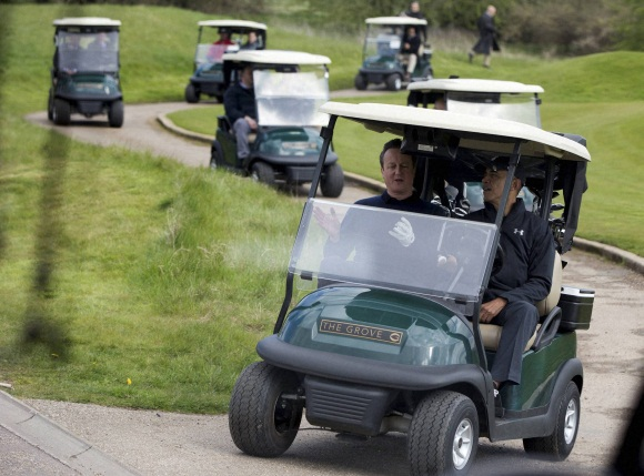 Barack Obama and David Cameron play golf at the Grove Golf Course
