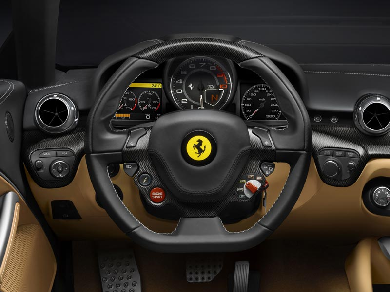 It comes with the, now standard, Ferrari steering wheel. Which pretty much concentrates all the buttons in a normal cabin onto the steering wheel. Note: you may need to take a masters-level course just to turn on the windshield wipers.