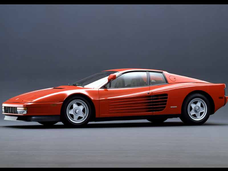 One of the most striking Ferrari's ever made, the Testarossa is one of those car designs that never gets old. The intakes on the sides were pretty large in size resulting in the elongated side strakes that eventually came to define the Testarossa. The grille at the front was a dummy and just housed the turn indicators. The repositioning of the radiator on the sides meant space for a larger boot!