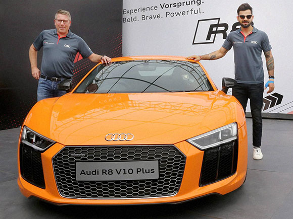 Virat kohli at the launch of the audi r8 v10 plus at taneja aerospace